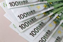 Banknotes worth 100 euros are on the table.  stock photo