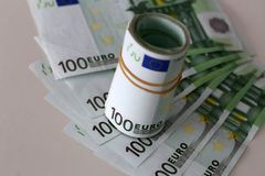 Banknotes worth 100 euros are on the table.  stock images
