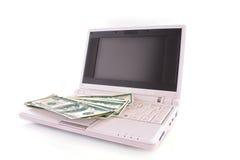 banknotu dolar laptop odosobniony laptop Zdjęcia Stock