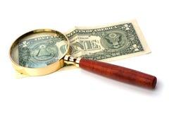 banknotu ręki magnifier Zdjęcia Stock