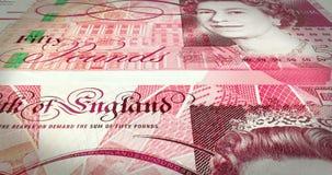 Banknoty pięćdziesiąt niezawodnych funtów stacza się na ekranie, gotówkowy pieniądze, pętla ilustracji