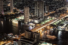 Bankok skyline by night highway and river traffic Stock Photos