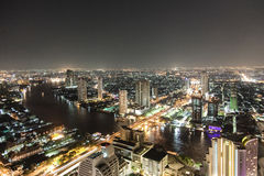 Bankok skyline by night highway and river traffic Stock Image