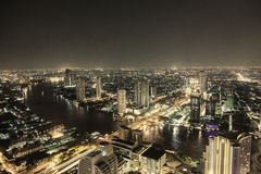 Bankok skyline by night highway and river traffic Royalty Free Stock Images