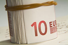 Bankroll. Tight roll of bills from an elastic rubber Stock Images
