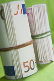 Bankroll. Tight roll of bills from an elastic rubber Royalty Free Stock Photos