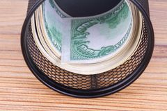Bankroll Cash Euro Banknotes in Garbage Basket. Focused on consuming in finance concept on wooden background Royalty Free Stock Photography