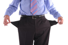Bankrupt. The gone bankrupt businessman stands with the turned out pockets stock image