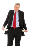 Bankrupt. Business man with empty pockets stock image