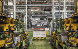 Bankrupt and abandoned automobile plant. The frame of the cab ca Stock Images