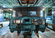 Bankrupt and abandoned automobile plant. The frame of the cab car on the production line. Bankrupt and abandoned automobile plant. The frame of the cab car on royalty free stock photography