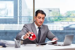 The bankrupt broke businessman with piggy bank Royalty Free Stock Photo