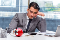 The bankrupt broke businessman with piggy bank. Bankrupt broke businessman with piggy bank royalty free stock image