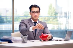 The bankrupt broke businessman with piggy bank Royalty Free Stock Image
