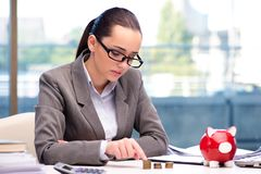 The bankrupt broke businesswoman with piggy bank Royalty Free Stock Image