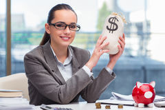 The bankrupt broke businesswoman with piggy bank Stock Photos