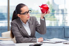 The bankrupt broke businesswoman with piggy bank Stock Photography