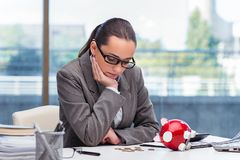 The bankrupt broke businesswoman with piggy bank Stock Images