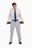 Bankrupt businessman showing his empty pockets Royalty Free Stock Image