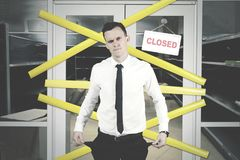 Bankrupt businessman is standing near his store royalty free stock photo