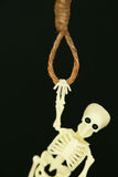 Bankrupt concept, rope noose with hangman's knot hanging in front, Halloween background.  Royalty Free Stock Photography