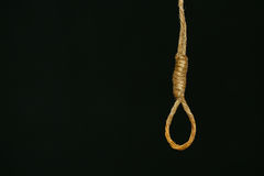 Bankrupt concept, rope noose with hangman's knot hanging in front, Halloween background Royalty Free Stock Photography