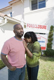 Bankrupt Couple Moving Out Of House. Multiethnic bankrupt couple moving out of house stock photography