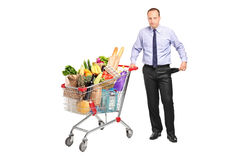 Bankrupt man holding a shopping cart. And gesturing no more money on white background stock images