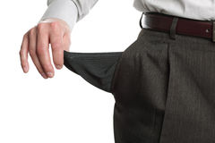 Bankrupt man showing empty pocket. Businessman pulling out his empty pocket in despair Royalty Free Stock Photo