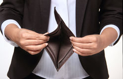 Bankrupt person showing empty wallet. Person in debt showing empty wallet Stock Image