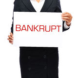 Bankrupt sign. Faceless business woman holding a sign saying bankrupt Royalty Free Stock Images