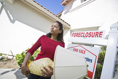 Bankrupt Woman Moving Out Of House Stock Photography