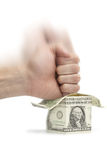 Bankruptcy. Human hand destroying dollar house. Property investment bankruptcy concept Stock Photography
