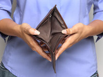 Bankruptcy. Business Person holding an empty wallet Stock Photo