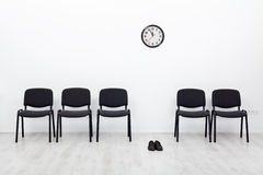 Bankruptcy and business failure concept. Deserted chairs and a pair of shoes Stock Photography