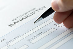 Bankruptcy. Close up of a person filling petition of bankruptcy form Stock Image