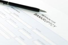 Bankruptcy. Close up of petition for bankruptcy form and pen Royalty Free Stock Photo