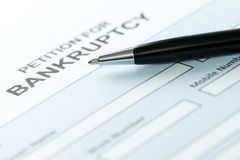 Bankruptcy. Close up of petition for bankruptcy form and pen Royalty Free Stock Image