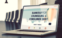 Bankruptcy Counseling and Consumer Debt Concept. 3D. Modern Meeting Hall with Laptop Showing Landing Page with Text Bankruptcy Counseling and Consumer Debt Royalty Free Stock Image