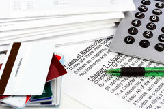 Bankruptcy document with bills. A bankruptcy document laying on a table below a calculator, bills, and a stack of credit cards.  Copy space available on top Royalty Free Stock Photos