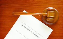 Bankruptcy filing. Petition and a court gavel Stock Photography