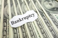 Bankruptcy headline. Bankruptcy news headline on cash Royalty Free Stock Photography