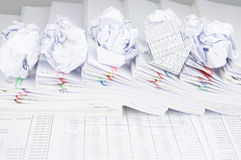 Bankruptcy of house and paper ball on pile of paperwork Stock Photo
