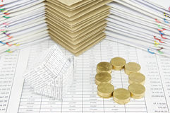 Bankruptcy of house and pile of gold coins as zero Stock Photo