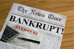 Bankruptcy. On the news paper Royalty Free Stock Photos