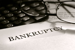 Bankruptcy Notice Letter with Glasses Stock Photo