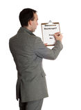 Bankruptcy Poll. The backside view of a businessman taking a bankruptcy poll, isolated against a white background Royalty Free Stock Image
