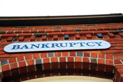 Bankruptcy Sign On Brick Building Stock Photos