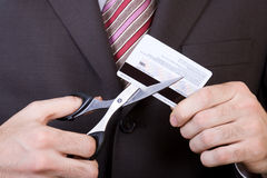 Bankruptcy - to scissors a credit card. Man's hands scissor the blocked credit card royalty free stock image