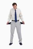 Bankruttt affärsman som visar hans tomma fack royaltyfri bild